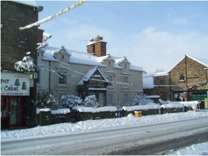 Lion Terrace as seen from the Lion Hotel in the snow of 2013. Stones Garage now stands on the plot of the original Croft Cottages as part of Berkins Court built 1796