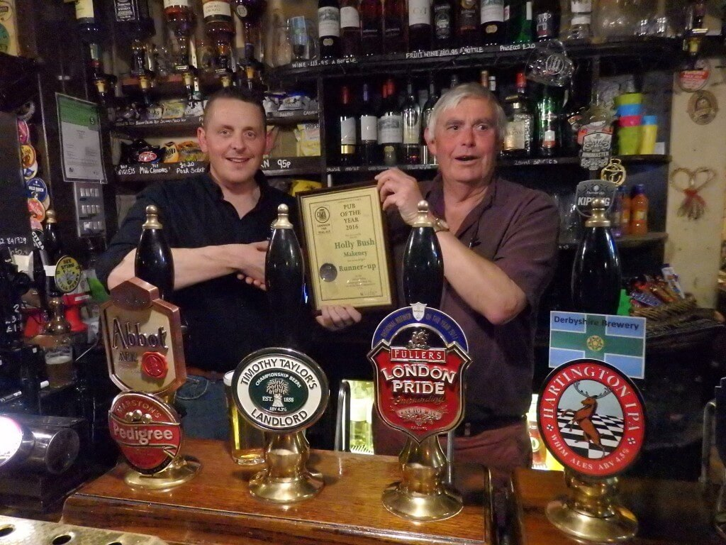 Chris Rogers presents the Pub runner-up award to Chris Wilbraham of the Holly Bush at Makeney.