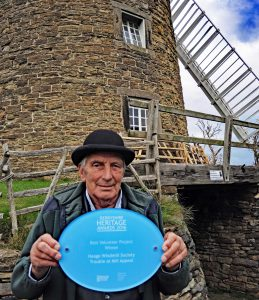 John Lea. One of our millers displays the plaque at the mill on Saturday.